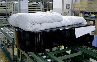 Pianos for customers in Japan are wrapped in heavy padded blankets