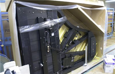 Legs are removed, and the piano is turned on its side for packaging
